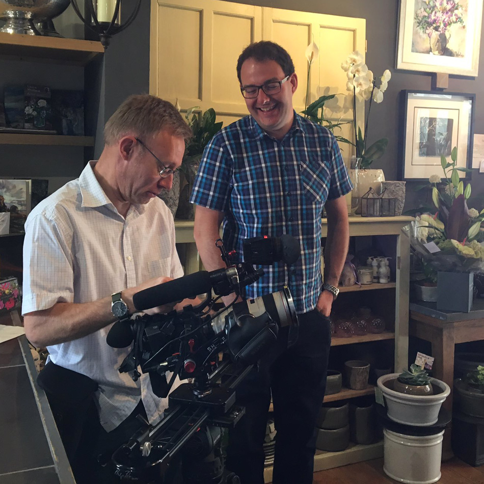 Michael Wood freelance video producer filming with a cameraman in a florist shop